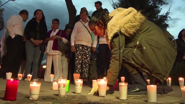 Families and neighbors of victims killed in a school that collapsed in last week's earthquake in Mexico City hold a vigil