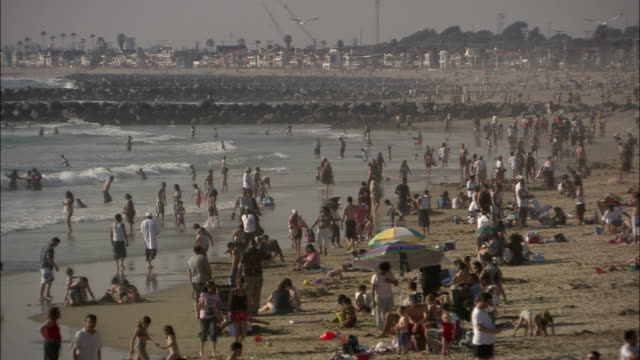 families enjoy a southern california beach. - cool box stock videos & royalty-free footage