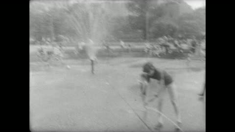 families enjoying washington square park in summer / children playing in fountain / children drinking sodas and coca-cola / woman eating popsicle on... - greenwich village stock videos & royalty-free footage