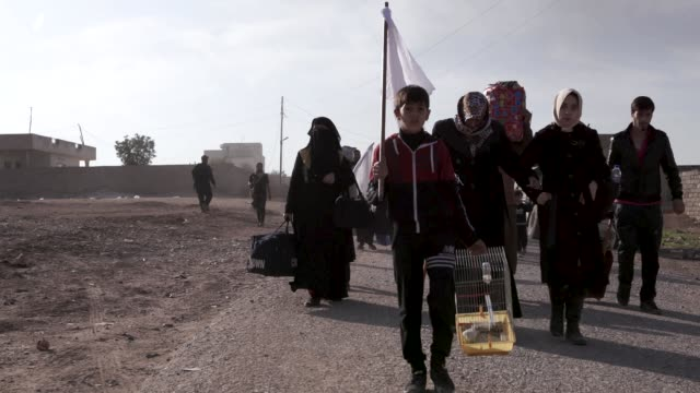 families fleeing the city of mosul thousands of civilians have fled the city of mosul due to the war against the islamic state - isis stock videos and b-roll footage
