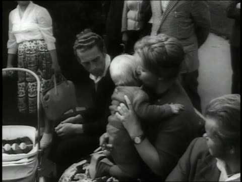 families from east berlin crowd refugee centers in west berlin. - east germany stock videos & royalty-free footage