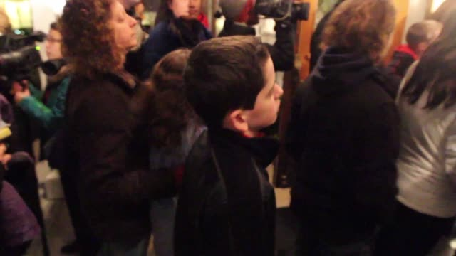 families gather after the shooting at the sandy hook elementary school at a vigil at st rose of lima parish 46 church hill rd newtown ct shooting at... - newtown connecticut stock videos & royalty-free footage