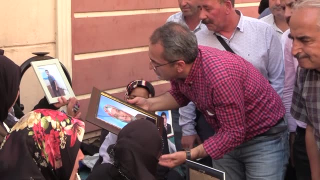 families join a sitin protest in order to raise their voice to save their children from the hands of the terror group outside the provincial office... - kurdistan workers party stock videos & royalty-free footage