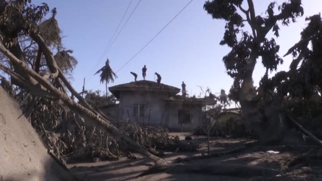 families living in areas affected by the taal volcano eruption return home to find their houses destroyed by the thick ash and mud ejected by the... - taal volcano stock videos & royalty-free footage