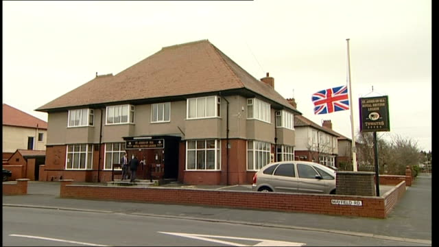 families of british soldiers killed in afghanistan explosion pay tribute; lancashire: lytham st annes: union jack flag flying at half mast outside... - リザムセントアンズ点の映像素材/bロール