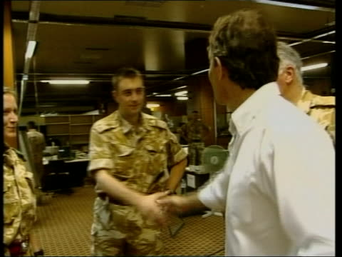 families of dead soldiers complain pool iraq basra prime minister tony blair mp along as shaking hands with soldiers pan blair listening as soldiers... - basra stock videos and b-roll footage