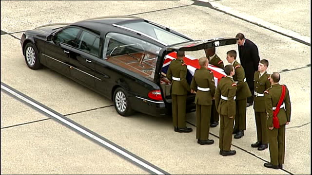 families of fallen soldiers bid to save chapel of rest lib / wiltshire lyneham ext coffin into hearse - carro funebre video stock e b–roll