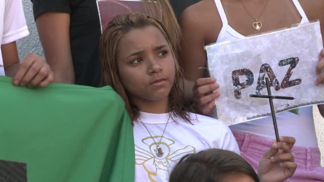 families of the victims of a 2011 school shooting in brazil prayed and sent a message of support friday to the victims of the shooting at the sandy... - sandy hook elementary school stock videos & royalty-free footage