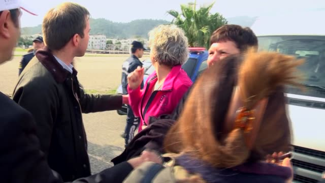 Families of three foreign students found alive after being missing for five days share their happiness with reporters on January 19 in Kemer district...