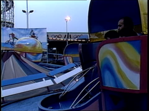 families on tilt a whirl ride at coney island - coney island brooklyn stock videos & royalty-free footage