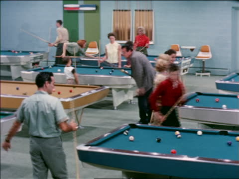1963 families playing pool in busy pool hall / industrial - pool hall stock videos and b-roll footage