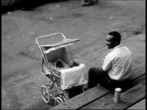 1965 montage families sitting with each other at a neighborhood baseball game / new york city, new york, united states - 1965 stock videos & royalty-free footage