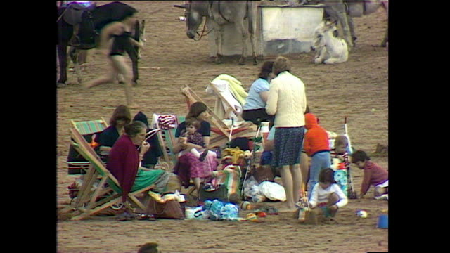 families spend time on weston-super-mare beach; 1978 - somerset england stock videos & royalty-free footage