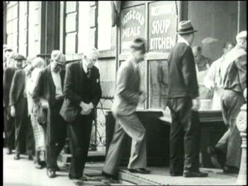 families stand in a bread line at a soup kitchen. - great depression stock videos & royalty-free footage