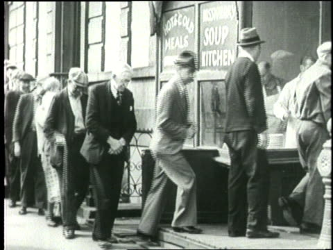 families stand in a bread line at a soup kitchen - 1932 stock-videos und b-roll-filmmaterial