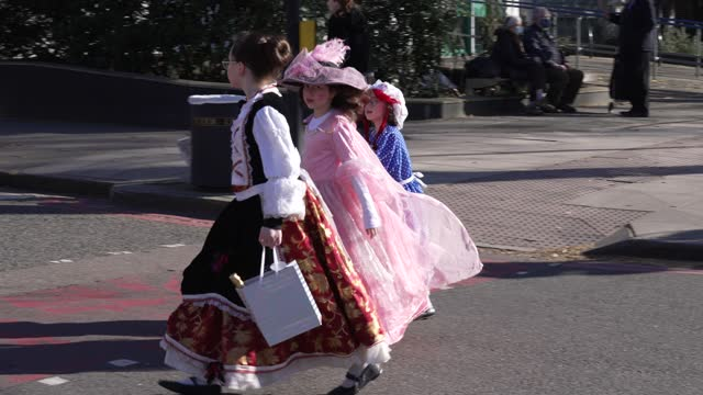 families walk through stamford hill with gifts during purim on february 26, 2021 in london, england. last year's purim occurred before the... - religion stock videos & royalty-free footage