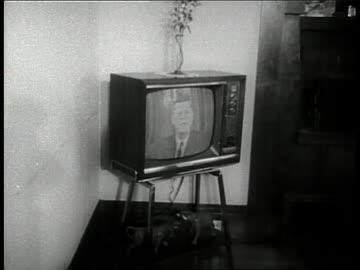 families watch the televised debate between senator john f. kennedy and senator richard nixon in 1960. - television show stock videos & royalty-free footage