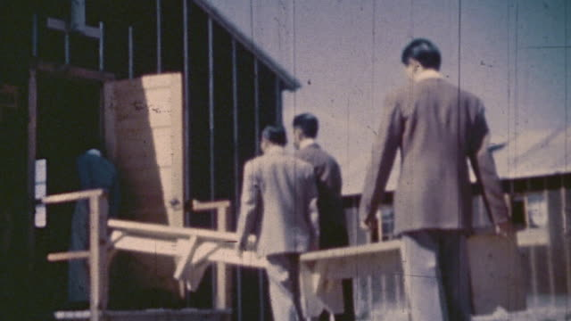 families worshiping at a world war ii war relocation center for interned citizens / united states - buddhism stock-videos und b-roll-filmmaterial