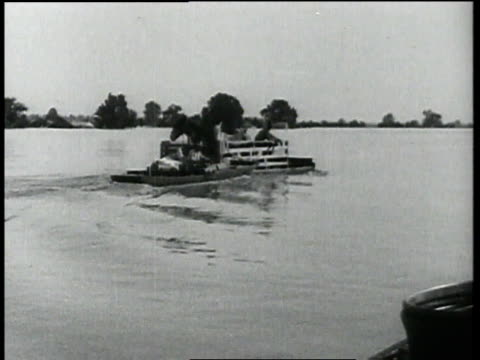family and animals floating on wood raft / united states - 1927 stock videos & royalty-free footage