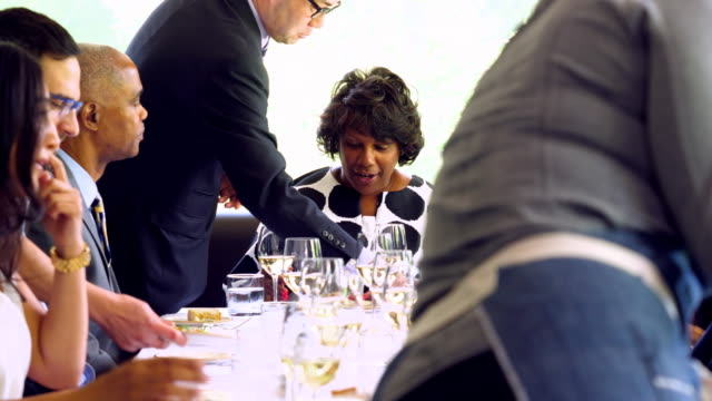 ms family and friends being served during celebration meal in restaurant - 35 39 years stock videos & royalty-free footage