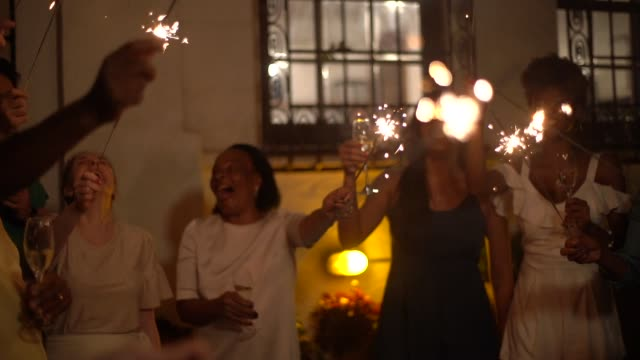 family and friends celebrating new year party with sparkler at home - minas gerais stock videos and b-roll footage