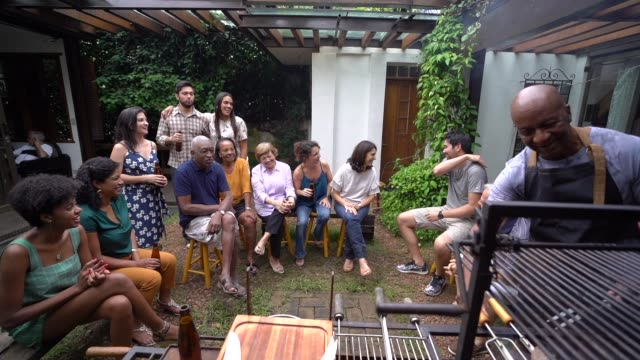 family and friends enjoying a barbecue party at home - large family stock videos & royalty-free footage
