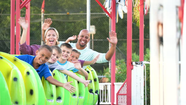 family and friends on amusement park ride, waving - mixed race person stock videos & royalty-free footage