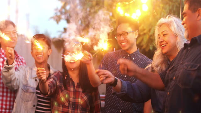 family and friends with sparklers - filippine video stock e b–roll