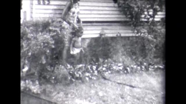 stockvideo's en b-roll-footage met 1955 family and sprinkler - african american ethnicity