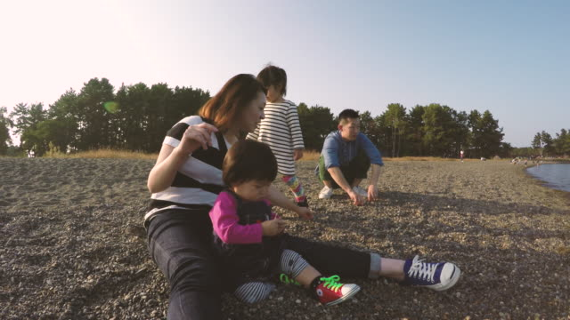 family are playing on the side of the lake - takashima shiga stock videos & royalty-free footage