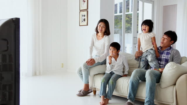ms family are watching television in room / fujikawaguchiko, yamanashi, japan - family watching tv stock videos and b-roll footage