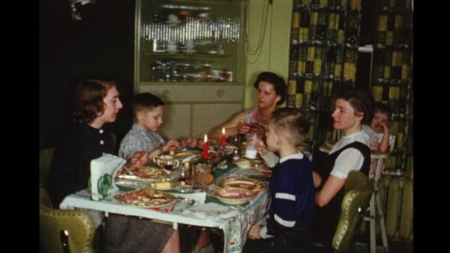1957 home movie family around dinner table / toronto, canada - home movie stock videos & royalty-free footage