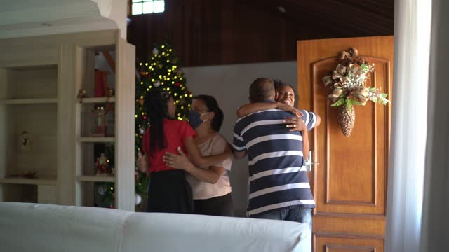 family arriving for christmas greeting by grandparents in the doorway at home - guest stock videos & royalty-free footage