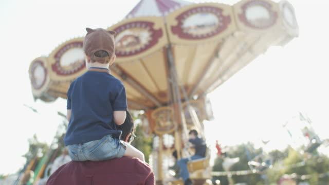 family at amusement park - amusement park stock videos & royalty-free footage