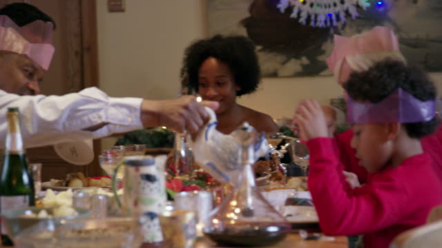 family at christmas dinner - jug stock videos & royalty-free footage