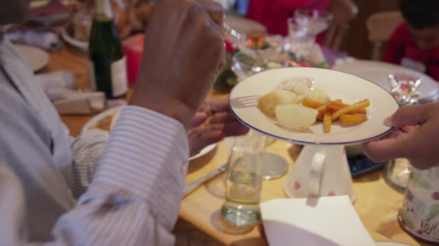 family at christmas table - roast turkey stock videos & royalty-free footage