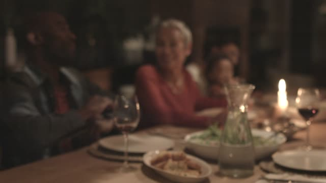 stockvideo's en b-roll-footage met family at dining table during family reunion - kleinzoon