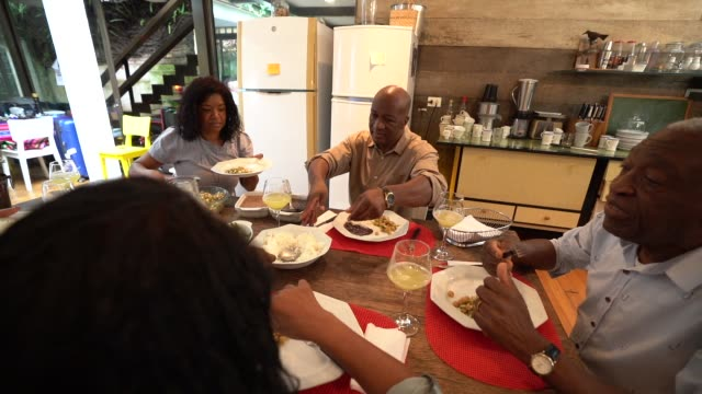 family at dinner / lunch time - thanksgiving plate stock videos & royalty-free footage