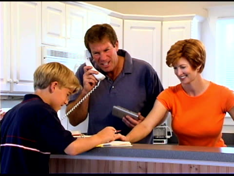 family at home in kitchen - see other clips from this shoot 1335 stock videos and b-roll footage