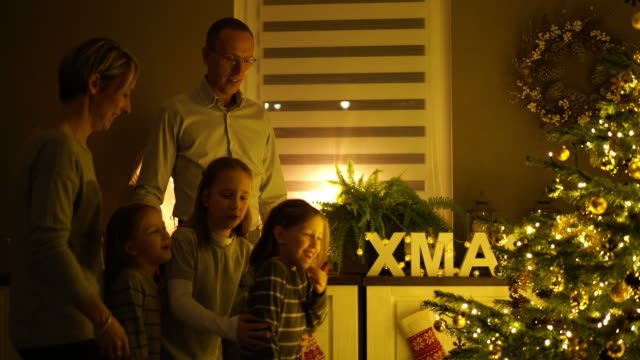 family at home on christmas evening