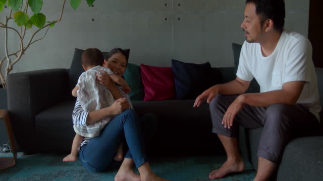 family at home - sofa stock videos & royalty-free footage