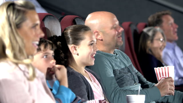 family at movie theater, eating popcorn, drinking soda - 40 49 years stock videos & royalty-free footage