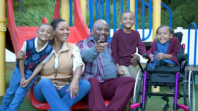 family at playground, girl in wheelchair, twin boys - 4 5 years stock videos & royalty-free footage