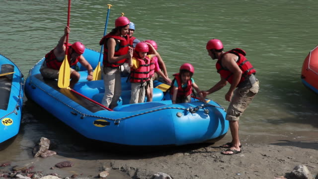 family at river rafting  - inflatable raft stock videos and b-roll footage