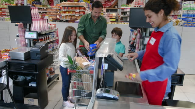family at shopping supermarket checkout cashier - cashier stock videos & royalty-free footage