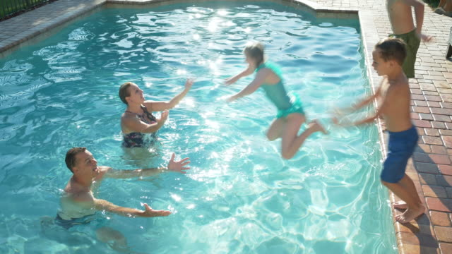 family at swimming pool, children jump in - 10 11 years stock videos & royalty-free footage