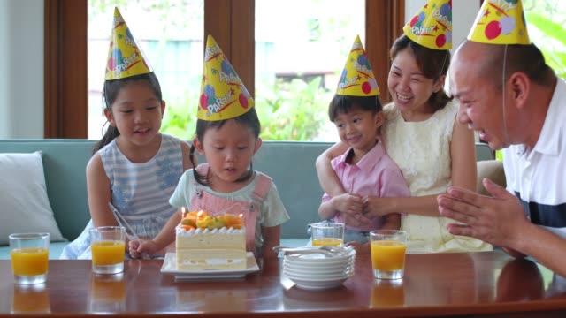 family birthday celebration - birthday candle stock videos & royalty-free footage