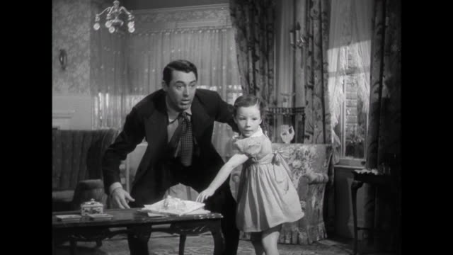 stockvideo's en b-roll-footage met 1941 a family ( cary grant & irene dunne) birthday surprise for mother - 1941