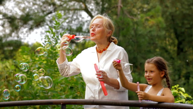 family blowing bubbles - bubble wand stock videos & royalty-free footage