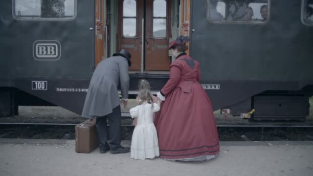 Family boarding old steam train